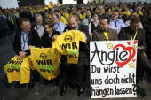 Worker of the Opel company wait for a visit of chancellor Angela Merkel on March 31 2009 in Ruesselsheim Germany The German carmaker Opel still needs...