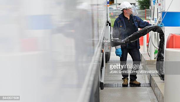 A worker of Transalliance fills up an isothermal trailer with liquid nitrogen at the gas station of Air Liquide on June 28 2016 in...