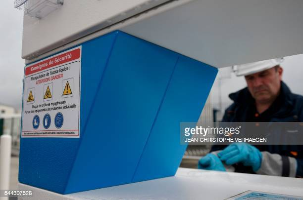 A worker of Transalliance prepares to fill up an isothermal trailer with liquid nitrogen at the gas station of Air Liquide on June 28 2016 in...