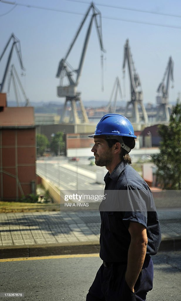A worker of Zamakona and La Naval shipyards takes part in a protest against the repayment of state aids by Spanish shipbuilders in the Northern Spanish Basque village of Sestao, on July 11, 2013. Brussels will decide by July 17 if the roughly three billion euros (4.0 billion USD) in state aid which Spanish shipbuilders received between 2005 and 2011 were unauthorised and if they will have to pay the money back. Unions have called for a day of protest and strikes on July 11 when European Union's commissioner for competition, Joaquin Almunia, will meet with representatives of Spanish shipbuilders in Brussels.