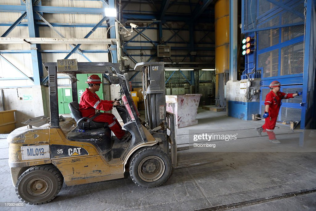 A worker operates a Caterpillar Inc. forklift in the No. 1 shaft building at the Oyu Tolgoi copper-gold mine, jointly owned by Rio Tinto Group's unit Turquoise Hill Resources Ltd. and Erdenes Oyu Tolgoi LLC, in Khanbogd, the South Gobi desert, Mongolia, on Friday, June 7, 2013. Rio Tinto, the world's second-biggest mining company, is expected to start first shipments from its $6.6 billion copper-gold mine in Mongolia this month. Photographer: Tomohiro Ohsumi/Bloomberg via Getty Images