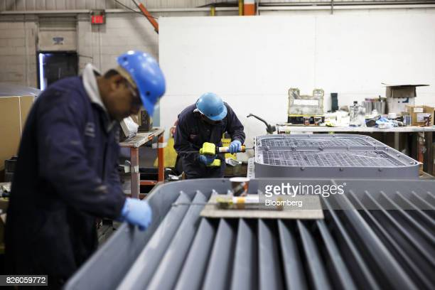 A worker operates a caulk gun at the Automatic Coating Ltd facility in Toronto Ontario Canada on Wednesday Jan 11 2017 Statistics Canada is scheduled...