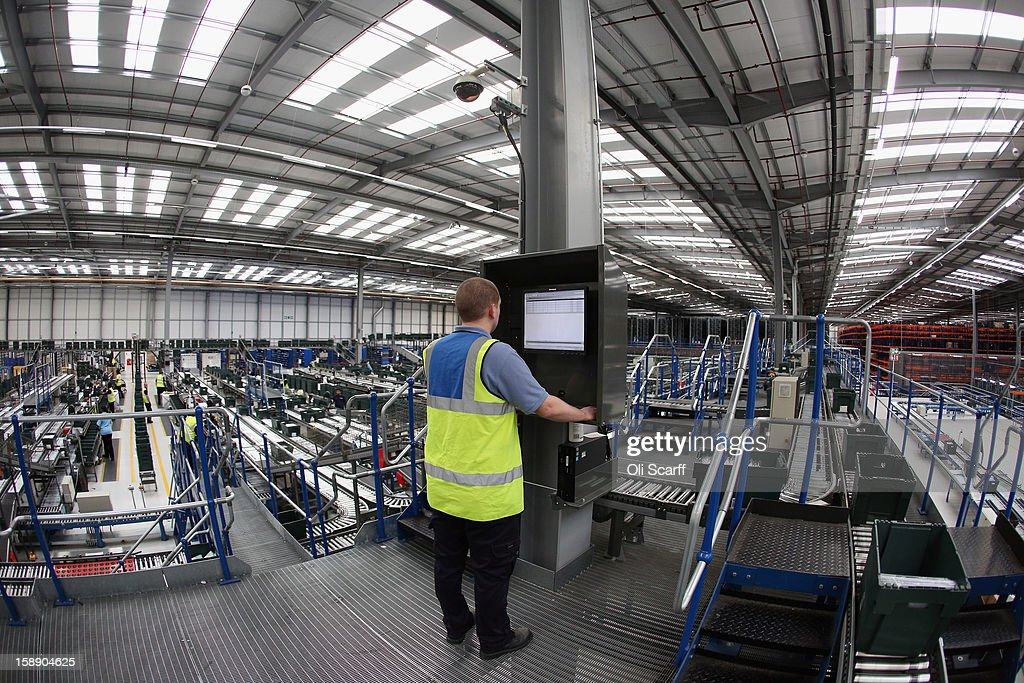 A worker operates a computer in the giant semi-automated distribution centre where the company's partners process the online orders for the John Lewis department store on January 3, 2013 in Milton Keynes, England. John Lewis has published their sales report for the five weeks prior December 29, 2012 which showed online sales had increased by 44.3 per cent over the same period in 2011. Purchases from their website Johnlewis.com now account for one quarter of all John Lewis business.