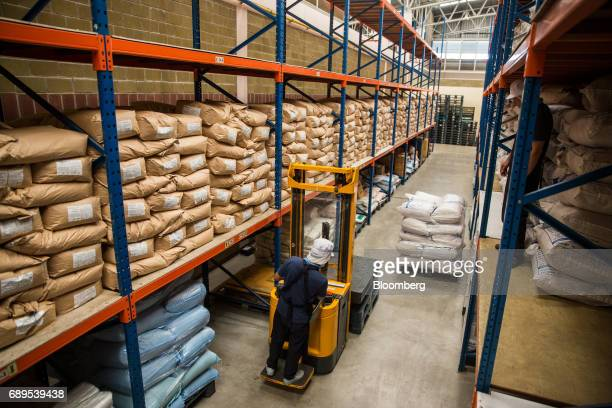A worker operates a forklift inside a warehouse at the Nithi Foods Co factory in the San Pa Tong district of Chiang Mai Thailand on Tuesday May 23...