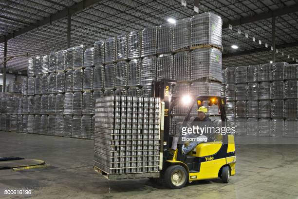 A worker operates a forklift to move pallets of canned vegetables at the Del Monte Foods Inc facility in Mendota Illinois US on Friday June 23 2017...