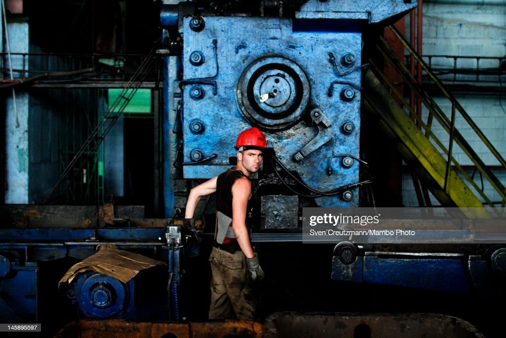 A worker operates a machine at the Antillana de Acero, Cuba's biggest steel plant, in the suburb of Cotorro, on June 7, 2012, in Havana, Cuba. The plant has a plan of producing 172.000 tons of steel in 2012. The production growth is expected to be between 15-18% in comparison to 2011.