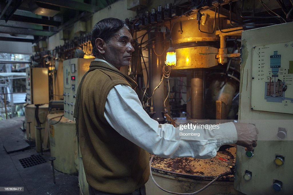 A worker operates a machine in the raw sugar manufacturing section of the Simbhaoli Sugars Ltd. mill in Ghaziabad, Uttar Pradesh, India, on Tuesday, Feb. 26, 2013. India, the world's biggest sugar producer, plans to seek a consensus among various ministries on ending four-decade old state controls on the domestic industry, Food Minister K.V. Thomas said. Photographer: Prashanth Vishwanathan/Bloomberg via Getty Images