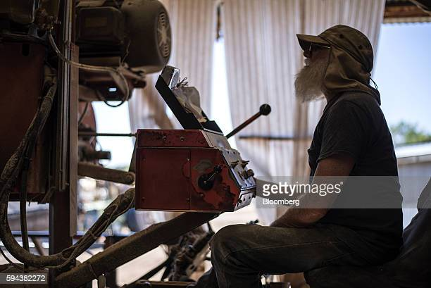 A worker operates a machine to cut logs at the Spotted Owl Timber Inc mill in Santa Fe New Mexico US on Monday Aug 15 2016 Founded in 1991 the family...