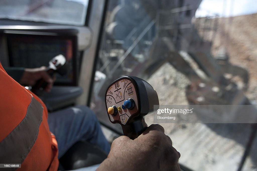 A worker operates a mining shovel machine at Grupo Mexico SAB's La Caridad open pit copper mine in Sonora, Mexico, on Monday, May 6, 2013. Grupo Mexico SAB, Mexico's biggest mining company by market value, estimates it will produce 840,000 tons of copper in 2013. Photographer: Susana Gonzalez/Bloomberg via Getty Images