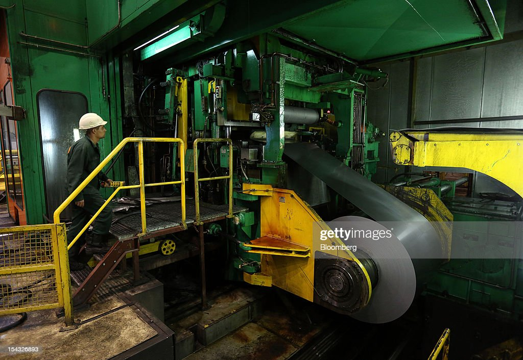 A worker operates a rolled steel module to coil steel sheet at the OAO Novolipetsk Steel plant, also known as NLMK, in Lipetsk, Russia, on Wednesday, Oct. 17, 2012. OAO Novolipetsk Steel, controlled by billionaire Vladimir Lisin, became Russia's largest steelmaker by output after boosting production by 24 percent. Photographer: Andrey Rudakov/Bloomberg via Getty Images