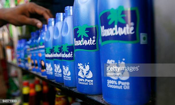 A worker organizes bottles of Marico Ltd coconut hair oil products at a department store in Mumbai India on Thursday Nov 8 2007 Marico Ltd...