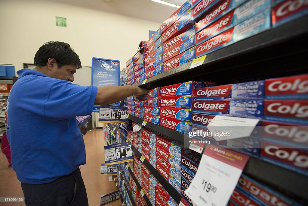 A worker organizes boxes of Colgate toothpaste at a Wal-Mart Stores Inc. location in Mexico City, Mexico, on Thursday, June 20, 2013. Mexican retail sales rose 2.5 percent in April from the same month last year, the country's statistics agency, known as Inegi, reported on its website. Photographer: Susana Gonzalez/Bloomberg via Getty Images