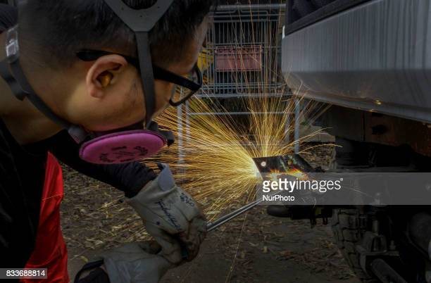 Worker oxyfuel gas cutting for front bumper renew at mohenic garages in Paju South Korea A 20yearold beat up Hyundai SUV isn't anyone's idea of a...