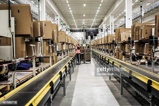 Worker pack orders at an Amazon warehouse on November 17 2015 in Brieselang Germany Germany is online retailer Amazon's second largest market after...