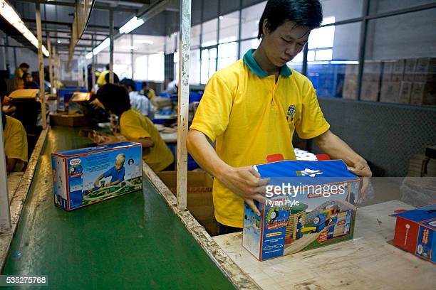 A worker packages a Thomas the Tank Engine and Friends toy train at the Li Cheng Industrial Park The Li Cheng Industrial Park houses several...