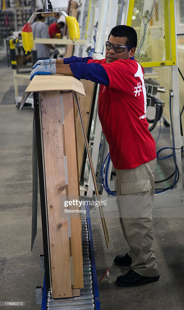 A worker packages finished windows at the Milgard Windows & Doors' manufacturing facility in Tacoma, Washington, U.S., on Wednesday, July 24, 2013. The U.S. Census Bureau is scheduled to release monthly factory orders figures on Aug. 2. Photographer: Tim Rue/Bloomberg via Getty Images