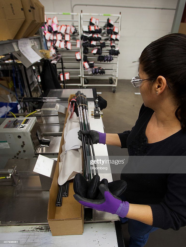 A worker packs a finished set of golf clubs for shipment at the Ping Inc. production facility in Phoenix, Arizona, U.S., on Tuesday, Dec. 17, 2013. The U.S. Census Bureau is scheduled to release durable goods figures on Dec. 24, 2013. Photographer: Tim Rue/Bloomberg via Getty Images