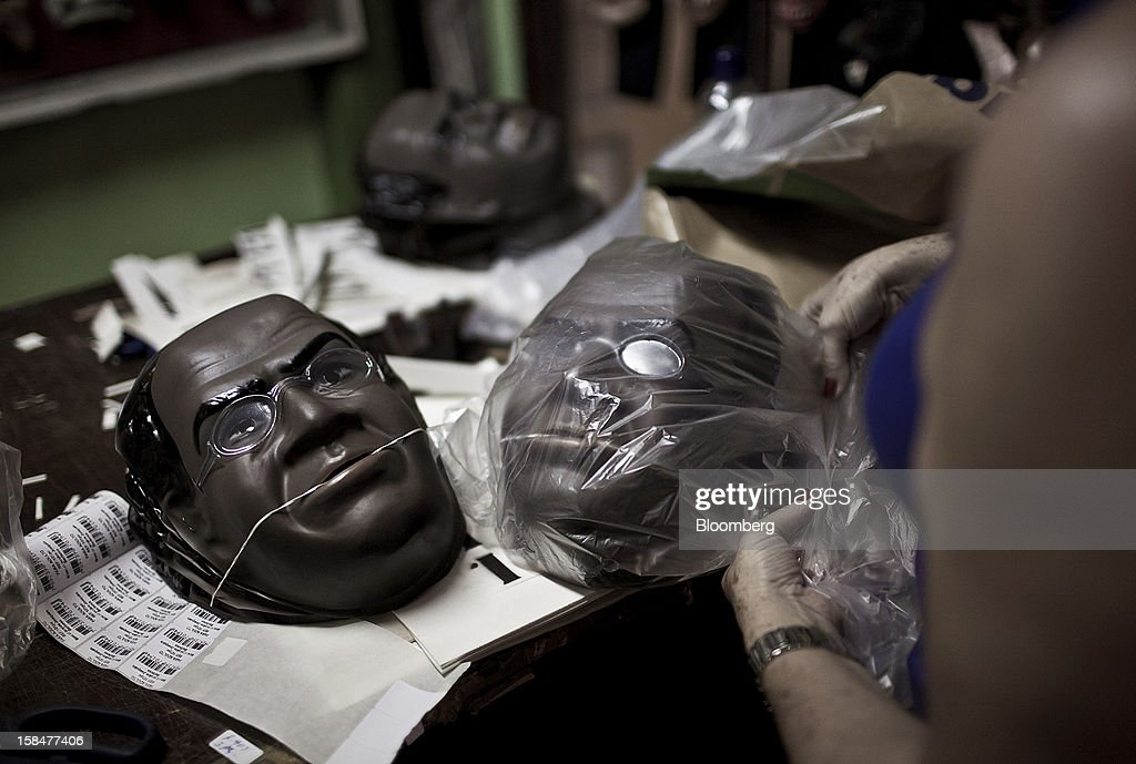 A worker packs Supreme Court Chief Justice Joaquim Barbosa Carnival masks for shipment at the Mascaras Condal factory in Sao Goncalo, Brazil, on Monday, Dec. 17, 2012. In a uniquely Brazilian measure of star status, Barbosa masks will be among the most popular during the Carnival celebration in February, according to Rio de Janeiro's O Globo newspaper. Photographer: Dado Galdieri/Bloomberg via Getty Images