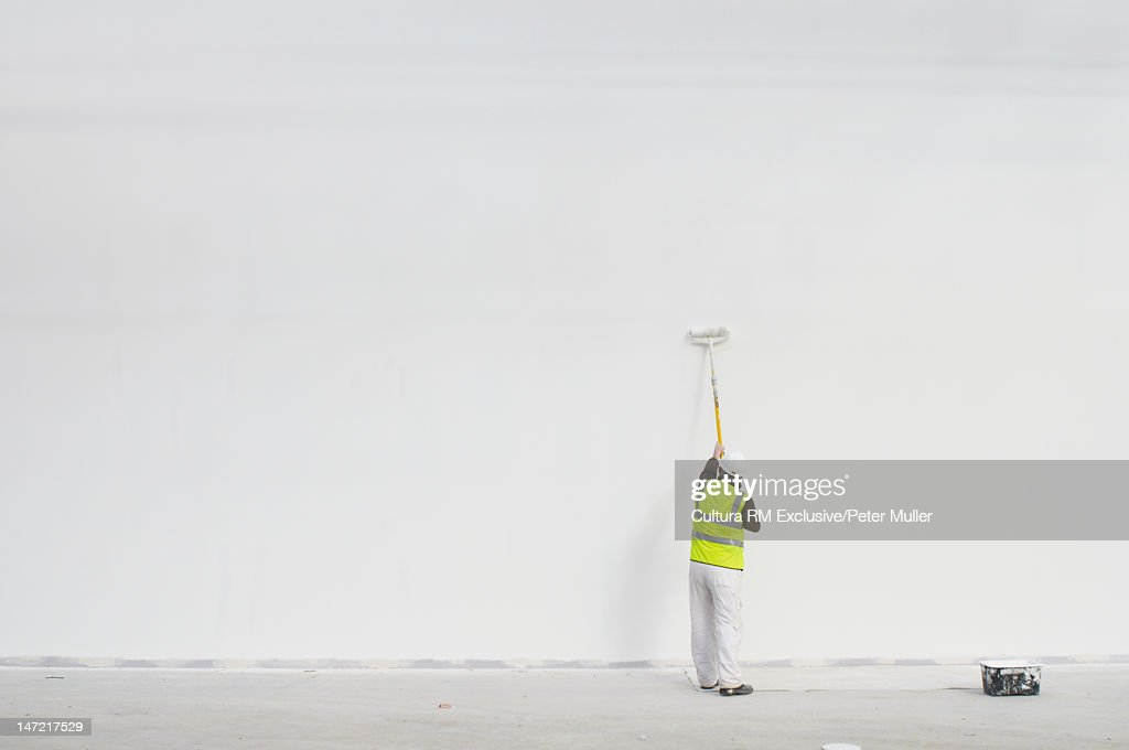 Worker painting on site : Stock Photo