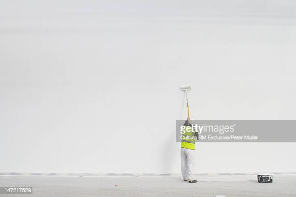 Worker painting on site