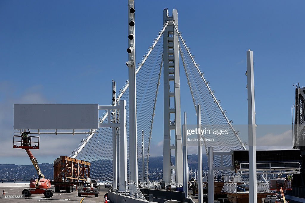 A worker paints a sign near the new Bay Bridge Self-Anchored Suspension (SAS) tower on August 26, 2013 in San Francisco, California. After nearly 12 years of construction and an estimated price tag of $6.4 billion, the new eastern span of the Bay Bridge is set to open on September 3. The bridge will be the world's tallest Self-Anchored Suspension (SAS) tower once completed.