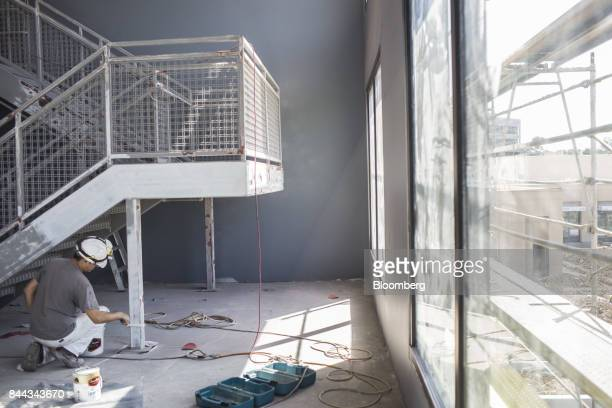 A worker paints a stairwell inside a two story fitness center at the Irvine Spectrum Marriott International Inc hotel a project of RD Olson...