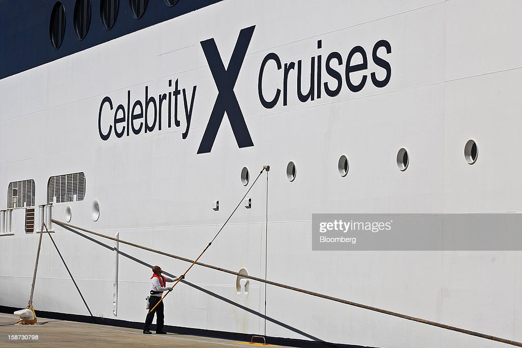 A worker paints the hull of Celebrity Cruises Inc.'s Constellation cruise ship while docked in Falmouth, Jamaica, on Monday, Dec. 17, 2012. Royal Caribbean Cruises Ltd. is a global cruise vacation company that operates Azamara Club Cruises, Celebrity Cruises, CDF Croisieres de France, Pullmantur Cruises and Royal Caribbean International. Photographer: Tim Boyle/Bloomberg via Getty Images