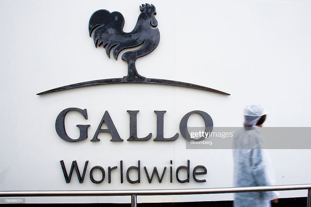 A worker passes a company logo at the entrance to the Gallo Worldwide olive oil plant in Abrantes, Portugal, on Friday, Dec. 14, 2012. The Iberian nation has already been granted more time to narrow its budget shortfall after tax increases failed to bring in enough money to meet forecasts as the economy heads for a third year of contraction in 2013. Photographer: Mario Proenca/Bloomberg via Getty Images