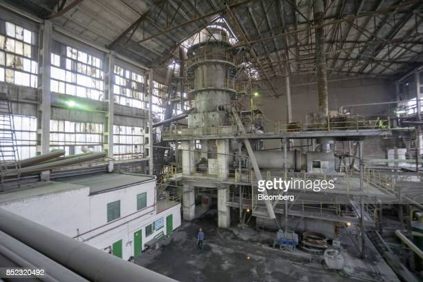 A worker passes near the turbine and chimney inside the EDF Man Ltd refinery in Nikolaev Ukraine on Friday Sept 22 2017 More sugar is coming to the...