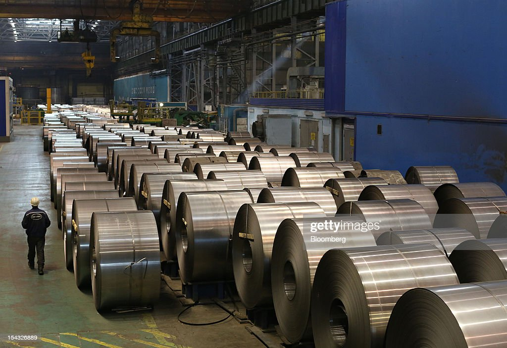 A worker passes stores of cold-rolled steel after manufacture at the OAO Novolipetsk Steel plant, also known as NLMK, in Lipetsk, Russia, on Wednesday, Oct. 17, 2012. OAO Novolipetsk Steel, controlled by billionaire Vladimir Lisin, became Russia's largest steelmaker by output after boosting production by 24 percent. Photographer: Andrey Rudakov/Bloomberg via Getty Images