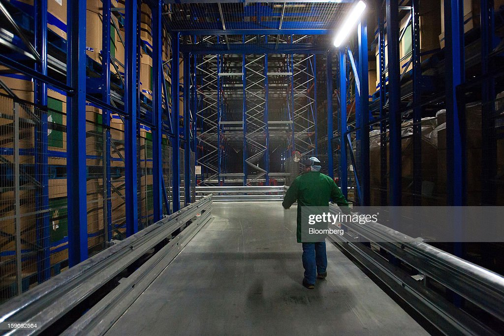 A worker passes through the industrial freezing section of the Monliz-Produtos Alimentares do Mondego e Liz SA frozen food factory in Alpiarca, Portugal, on Friday, Jan. 18, 2013. Portuguese Prime Minister Pedro Passos Coelho says he does not want Portugal to get a second rescue program. Photographer: Mario Proenca/Bloomberg via Getty Images