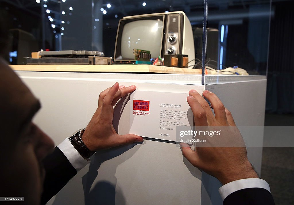 A worker places an information placard on a display of an Apple-1 computer, built in 1976, during the First Bytes: Iconic Technology From the Twentieth Century, an online auction featuring vintage tech products at the Computer History Museum on June 24, 2013 in Mountain View, California. Christie's is auctioning off an original Apple-1 computer owned by Ted Perry as part of its First Bytes: Iconic Technology from the Twentieth Century, an online auction of vintage tech products. The online auction begins today and runs through July 9. The Apple-1 is expected to fetch between $300,000 and $500,000.
