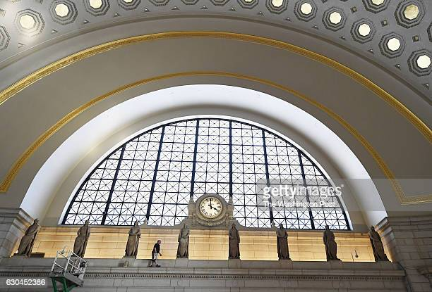 A worker places lighting equipment prior to an event to commemorate the restoration of the main hall at Union Station on Thursday October 13 2016 in...