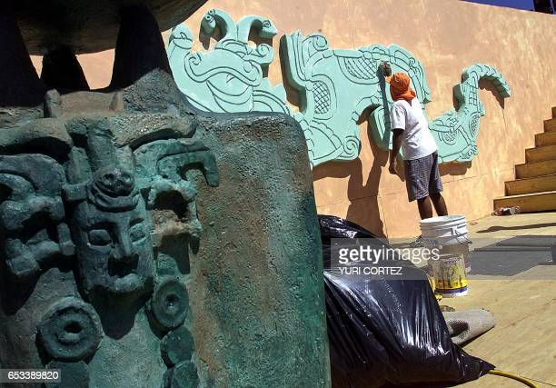 A worker places the final touches on the stage of the National Stadium of Flora Blanca in San Salvador El Salvador 22 November 2002 where the 'XIX...