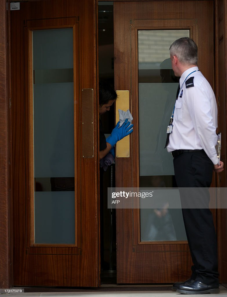 A worker polishes a door plate on the main entrance to the Lindo Wing of Saint Mary's Hospital in Paddington, west London on July 9, 2013. Prince William and his wife Catherine's baby, which will be third in line to the throne, will be born in the private Lindo wing of St Mary's Hospital, where William was born in 1982 and his brother Harry in 1984.