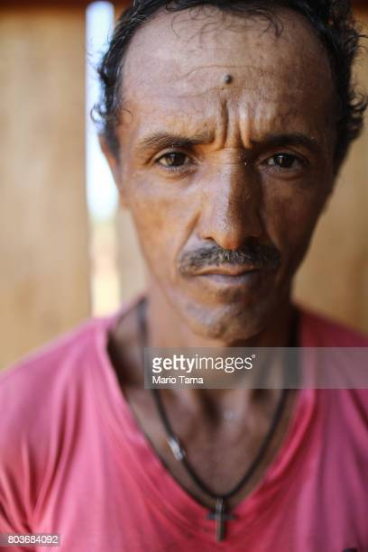 A worker poses at a sawmill in a deforested section of the Amazon on June 26 2017 near Porto Velho Brazil Workers earn about $21 USD per day at the...