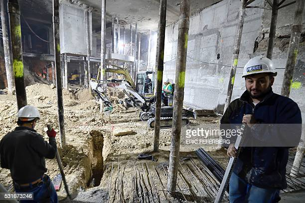 A worker poses during renovations on the third basement level of the Lutetia hotel on May 12 2016 in Paris The renovation of the prestigious Parisian...