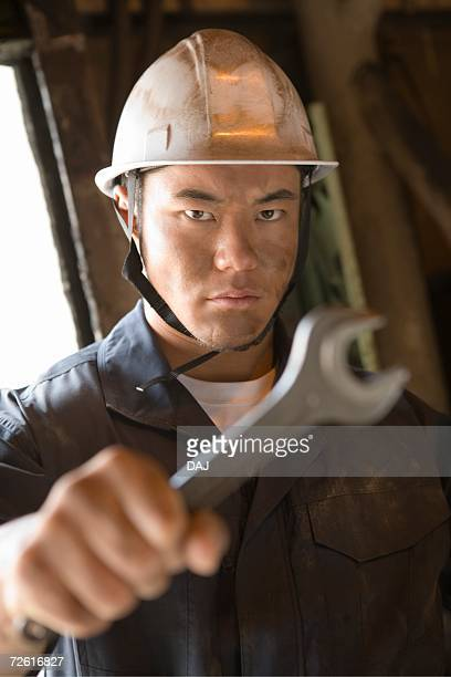 Worker posing, Front View, Differential Focus