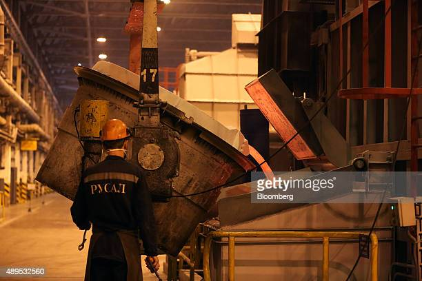A worker pours molten aluminum from a crucible at the Irkutsk aluminium smelting plant operated by United Co Rusal in Shelekhov Russia on Monday Sept...