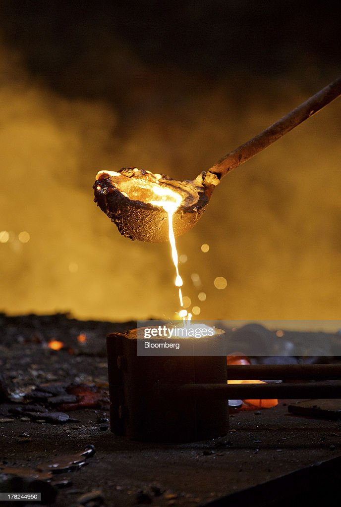 A worker pours molten steel from a ladle into a mould at ArcelorMittal's steel plant in Ostrava Czech Republic on Monday Aug 26 2013 ArcelorMittal...