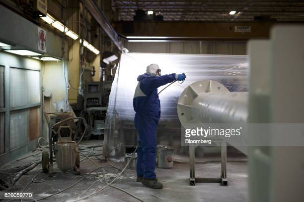 A worker powder coats a pole at the Automatic Coating Ltd facility in Toronto Ontario Canada on Wednesday Jan 11 2017 Statistics Canada is scheduled...