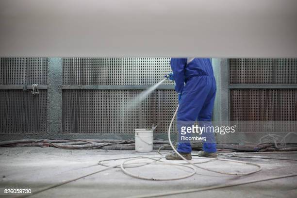 A worker powder coats pipes at the Automatic Coating Ltd facility in Toronto Ontario Canada on Wednesday Jan 11 2017 Statistics Canada is scheduled...