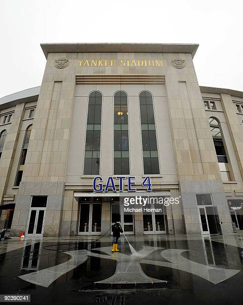A worker power washes the Yankee logo outside of Gate 4 a day before Game One of the 2009 MLB World Series between the New York Yankees and the...