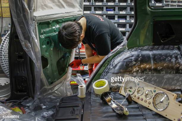 Worker prepare for inner coating at mohenic garages in Paju South Korea A 20yearold beat up Hyundai SUV isn't anyone's idea of a dream car But used...