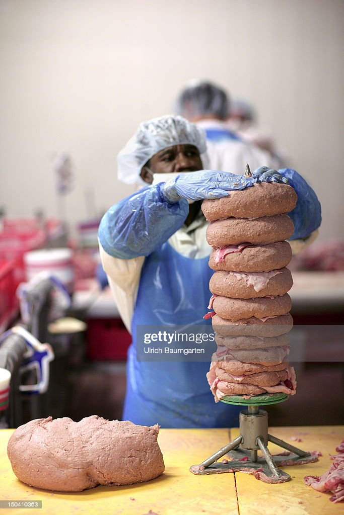 A worker prepares a Doener Kebab meat skewer at Karmez Doenerfabrik GmbH, on July 31, 2012 in Frankfurt am Main, Germany.