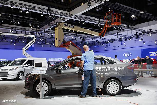 A worker prepares a Ford Motor Co Fiesta subcompact vehicle ahead of the Los Angeles Auto Show in Los Angeles California US on Tuesday Nov 17 2015...