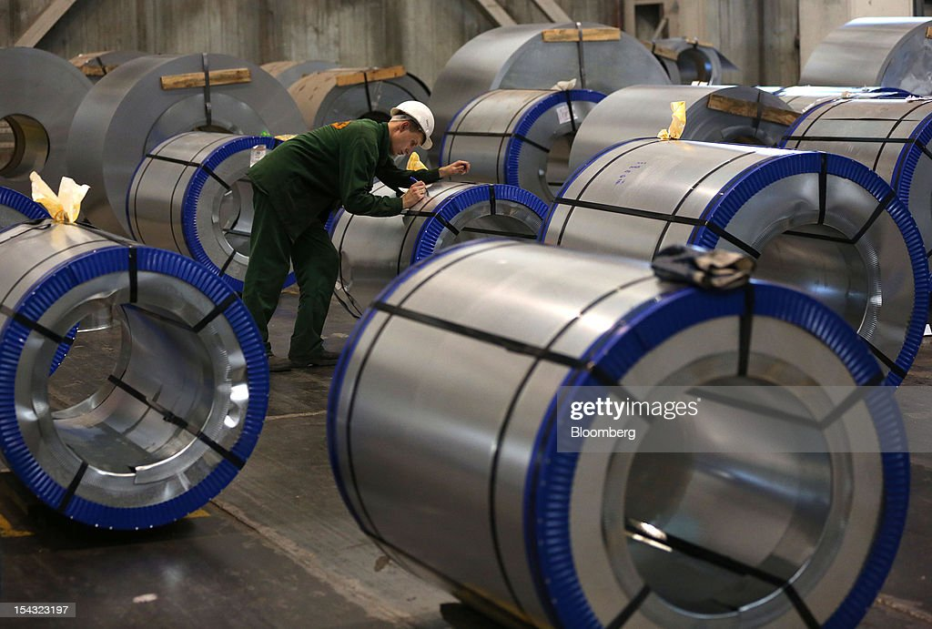 A worker prepares a galvanised steel roll for shipping at the OAO Novolipetsk Steel plant, also known as NLMK, in Lipetsk, Russia, on Wednesday, Oct. 17, 2012. OAO Novolipetsk Steel, controlled by billionaire Vladimir Lisin, became Russia's largest steelmaker by output after boosting production by 24 percent. Photographer: Andrey Rudakov/Bloomberg via Getty Images