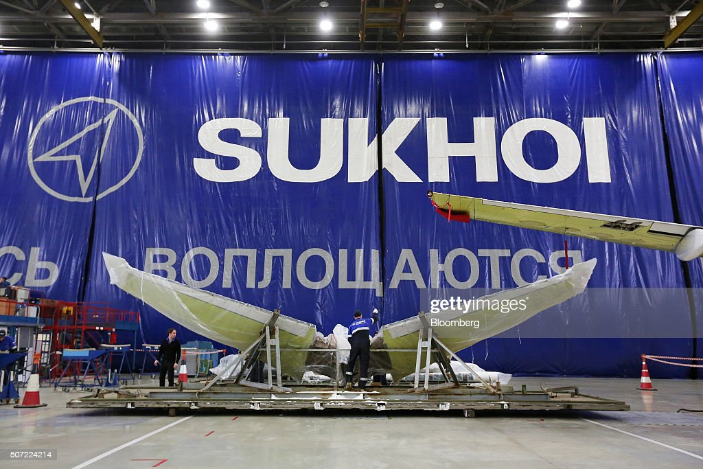 A worker prepares a horizontal stabilizer section before fitting to a Sukhoi Superjet 100 aircraft at the Sukhoi Civil Aircraft Co final assembly...
