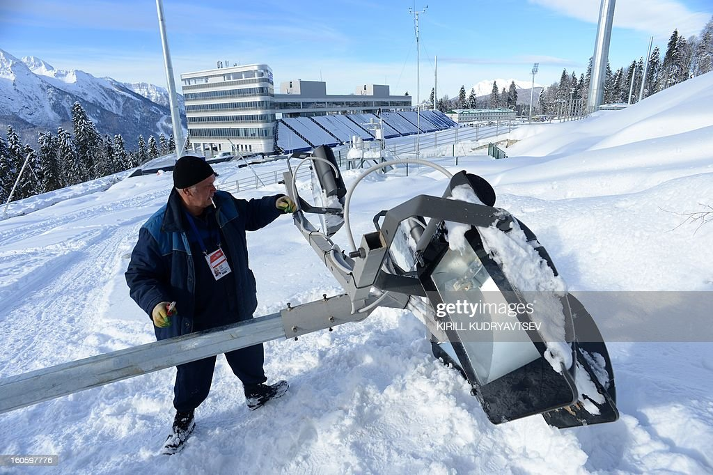 A worker prepares a lamp on the shooting range of the Laura Cross Country and Biathlon Center in Russian Black Sea resort of Sochi on February 3, 2013.