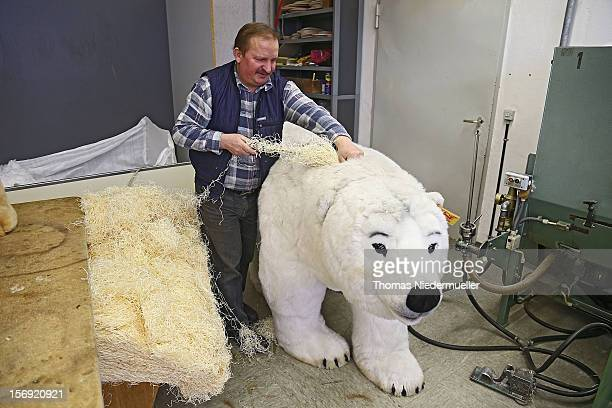 A worker prepares a polar bear at the Steiff stuffed toy factory on November 23 2012 in Giengen an der Brenz Germany Founded by seamstress Margarethe...